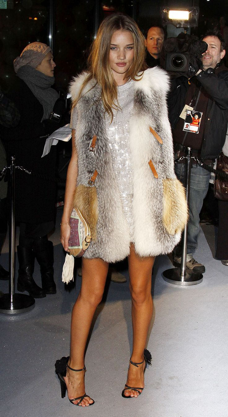 Rosie Huntington-Whiteley in Fur-Why do people have the perception they look sexy or pretty in fur? It looks dated and sad. The only place a fur looks beautiful on is the animal.