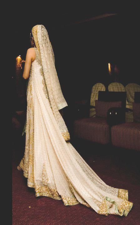 A lovely long train on a south Asian bride. White and gold Indian bridal