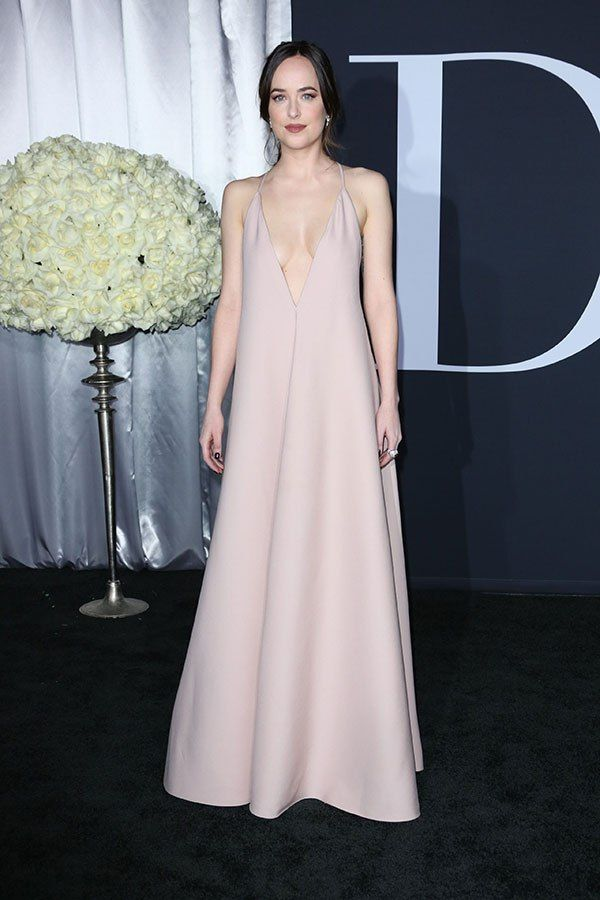 Dakota Johnson smoulders as she goes braless for the Fifty