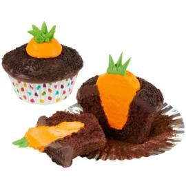 Bunny's Carrot Garden Easter Cupcakes- just bake chocolate cupcakes, frost with chocolate frosting, sprinkle dirt (crushed chocolate sandwich cookies), cut out a hole for the carrot, pipe the space with orange frosting, add green for the tops, done!! I think this is one I will actually be able to pull off!
