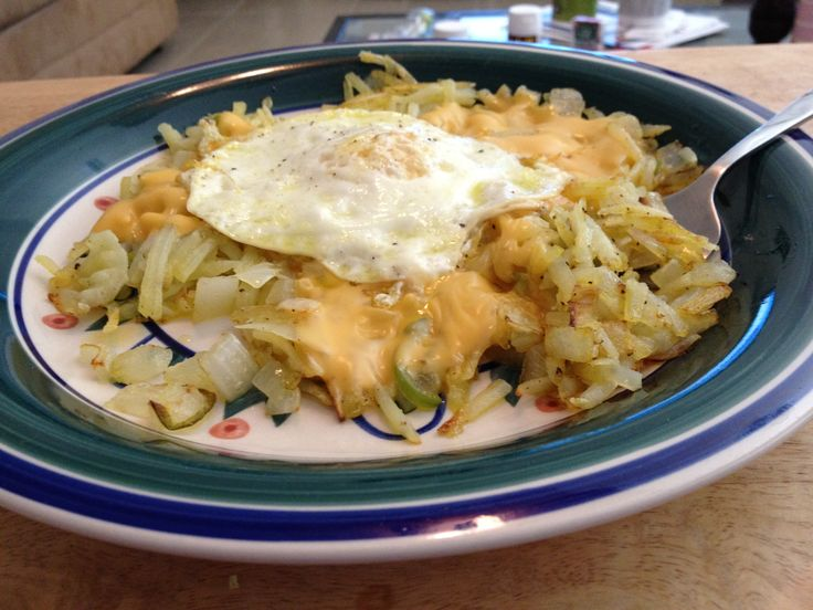 Hash browns with onions, jalapeno, and cheese with an egg on top.