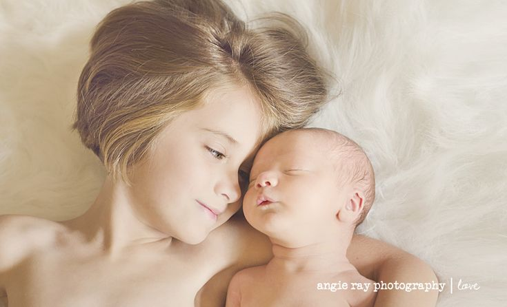 """Angie Ray - """"My 6 year old Lucie with her then 5-days new little brother Eliot. Her expression was not posed, I had wanted her to look at the camera but he did a little sigh in his sleep and she said 'aww' and turned her head towards him and closed her eyes. I teared up as I clicked the shutter, so magical."""""""