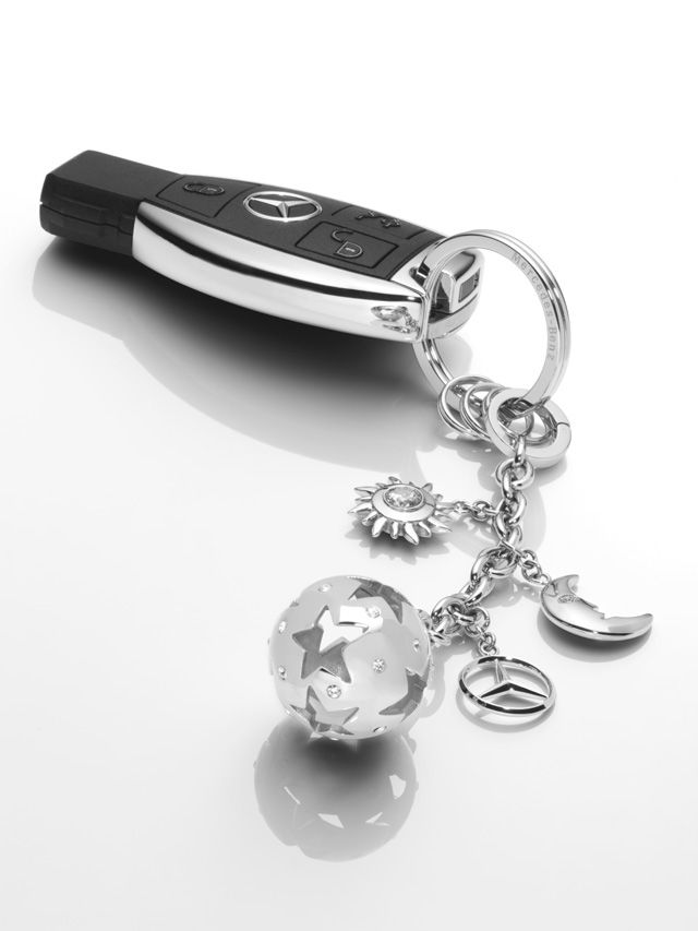 """B66952635  Barcelona key ring. Silver-coloured. High-sheen polished stainless steel. Flat split ring with 3 mini split rings.  Snap hook. Mobile phone loop. Can be used as key ring, mobile phone charm or attached to handbag.  With CRYSTALLIZEDβ Swarovski Elements. 3D star logo as fob. """"""""Mercedes-Benz"""""""" lettering engraved on split ring."""