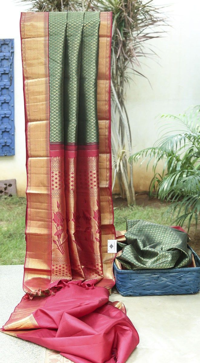Green kanchivaram with a woven zari body. The body is complemented by a maroon border and pallu textured with a zari weave