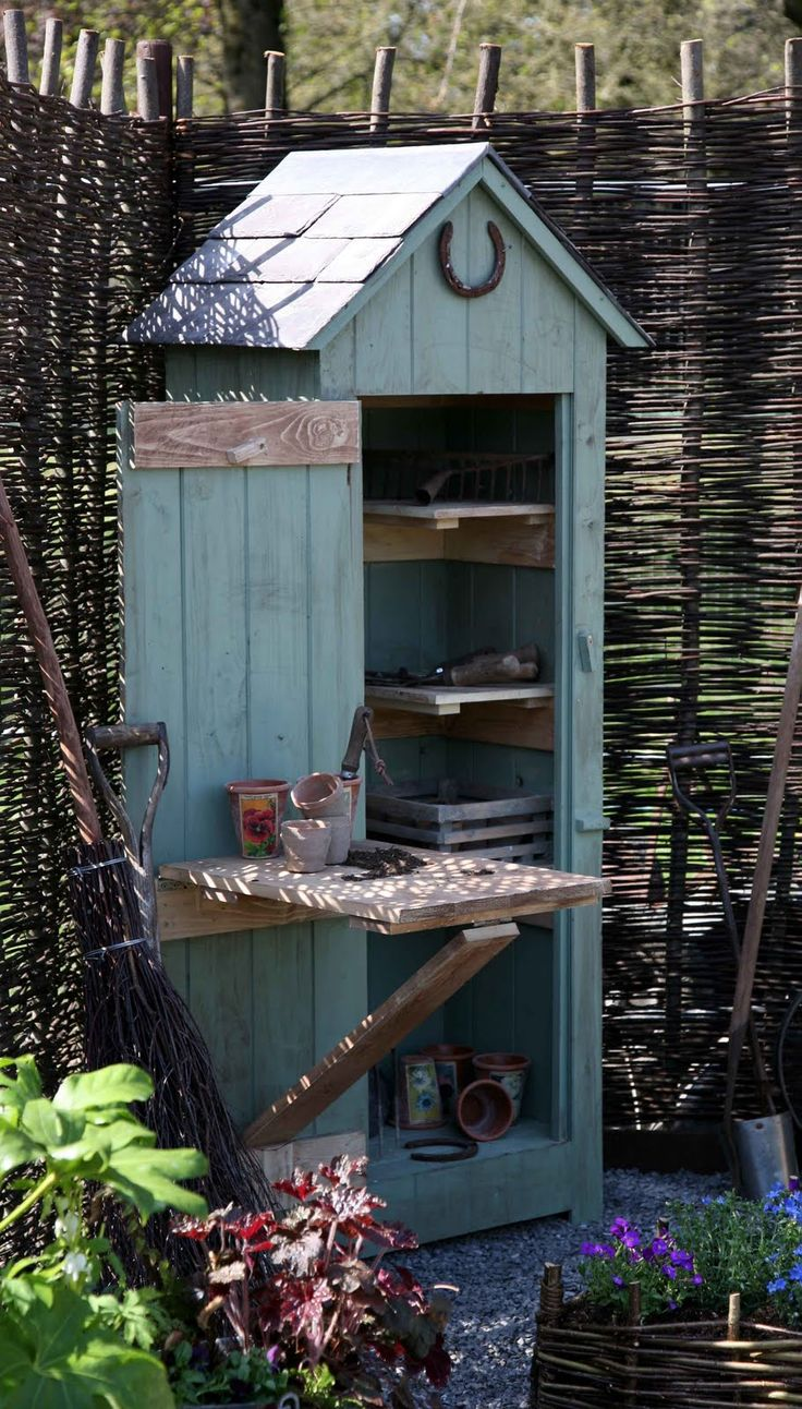 Cute Potting Shed Small but serves the purpose. Love the fold down table!