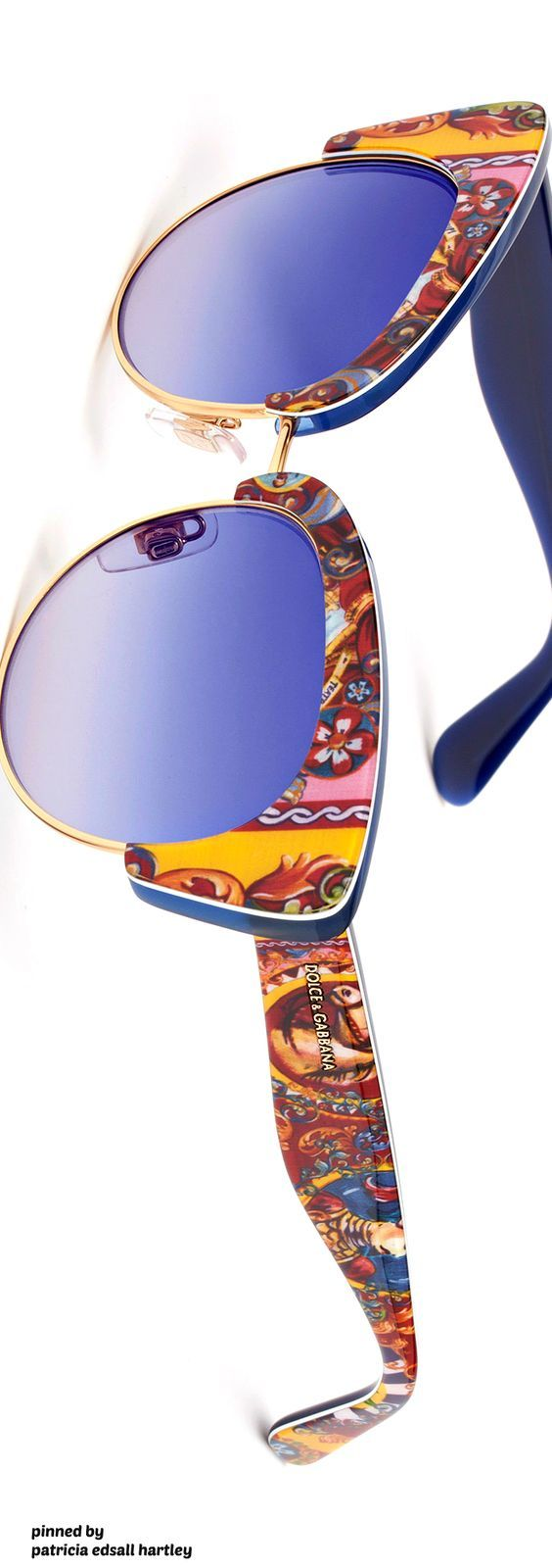 259ee6a6ba8826 Cat-eye sunglasses for women Dolce   Gabbana with acetate and metal frame  and blue gradient lenses. Sicilian Carretto print on frontal and temples.