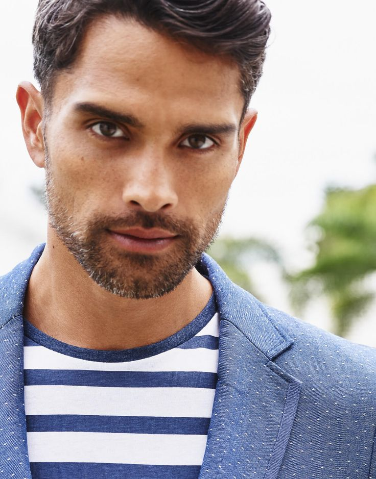 Stylish dads will appreciate a gift from Winners like a men's blue spring blazer paired with stripped white and blue shirt underneath.