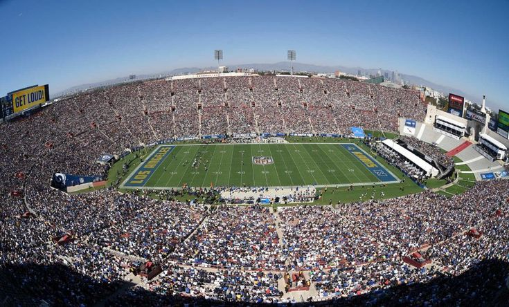 The Los Angeles Memorial Coliseum is seen with downtown Los Angeles, at right, during the first half an NFL football game between the Los Angeles Rams and the Seattle Seahawks, Sunday, Sept. 18, 2016, in Los Angeles.