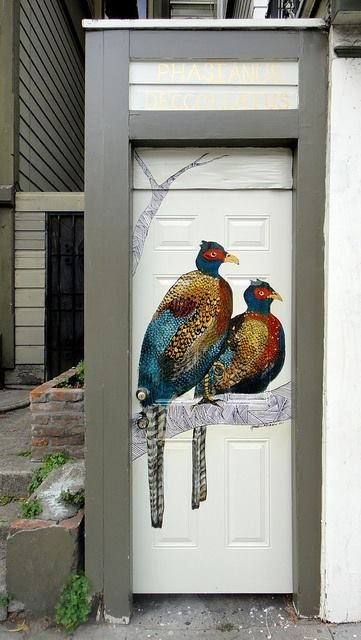 THIS IS A SIDE DOOR TO THEIR GARAGE……JUST PRESS ON EITHER BIRD AND THEY START CHEEPING…………ccp