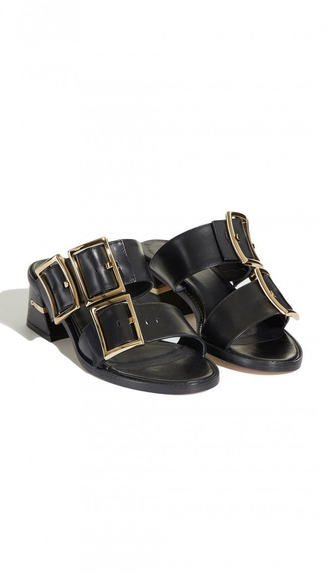 Timeless and understated, this thick-strap angular low-heeled sandal has been constructed in Italy from the highest quality leather. In their simple elegance with standout gold buckles, they will work with anything.    100% Leather  Made in Italy  Style Number: SR116KAR5164  Available in: Black, Ribbon Red, Gold