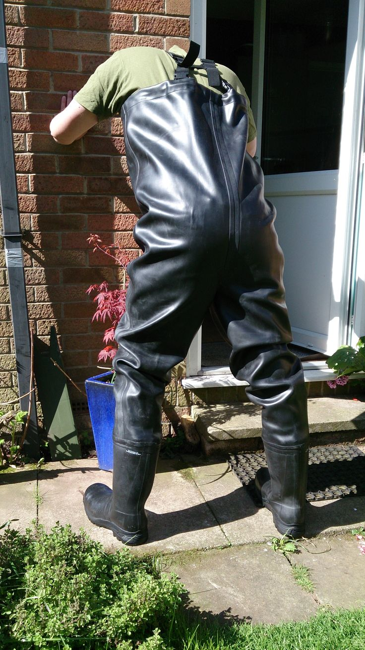BAKING IN RUBBER CHEST WADERS IN THE HOT SUN. Poor guy
