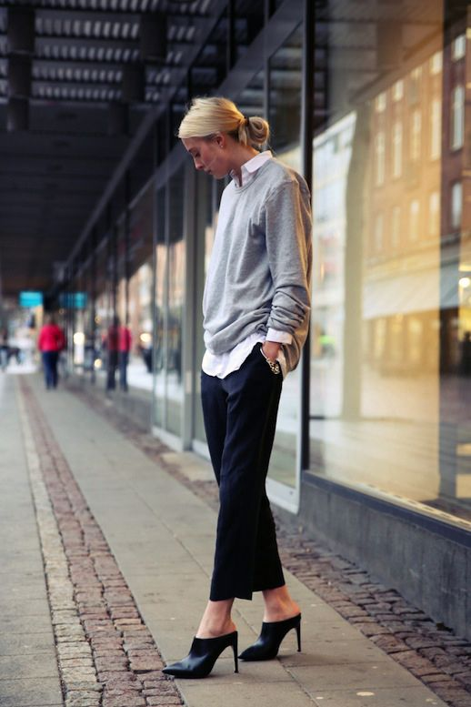 Grey sweater, white shirt, black pants, black mules.
