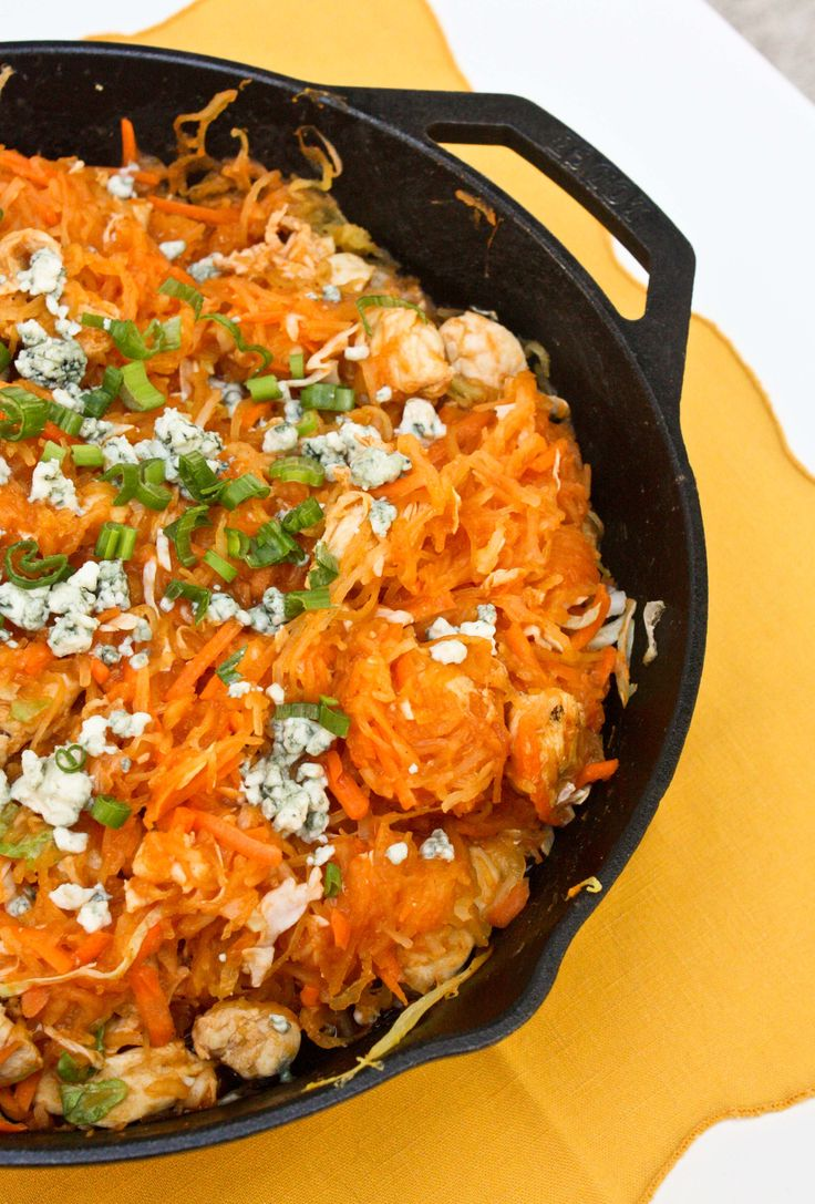 Buffalo Chicken Spaghetti Squash.  Quick and easy healthy dinner! 1 spaghetti squash3-4 green onions 1-2 lbs chicken breast, cut into bite sized pieces 1-2 tbsp olive oil 1 tsp garlic powder 1 tbsp onion powder 1 cup shredded carrots 1 cup shredded cabbage (I bought cole slaw mix) 1 cup Frank's Buffalo Sauce (or more if you'd like)