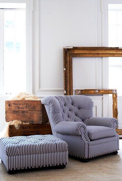 blue ticking stripe on large tufted chair. Coastal inspiration from Ralph Lauren Home.
