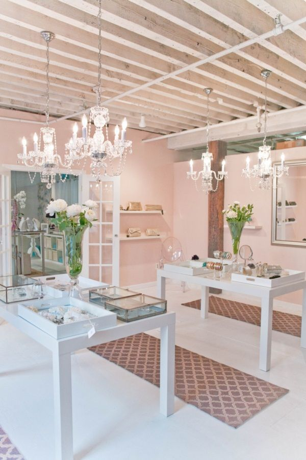 Lovely store display. #stores #shops #displays #pink #peach #cream #white #chandelier #flowers #gray grey