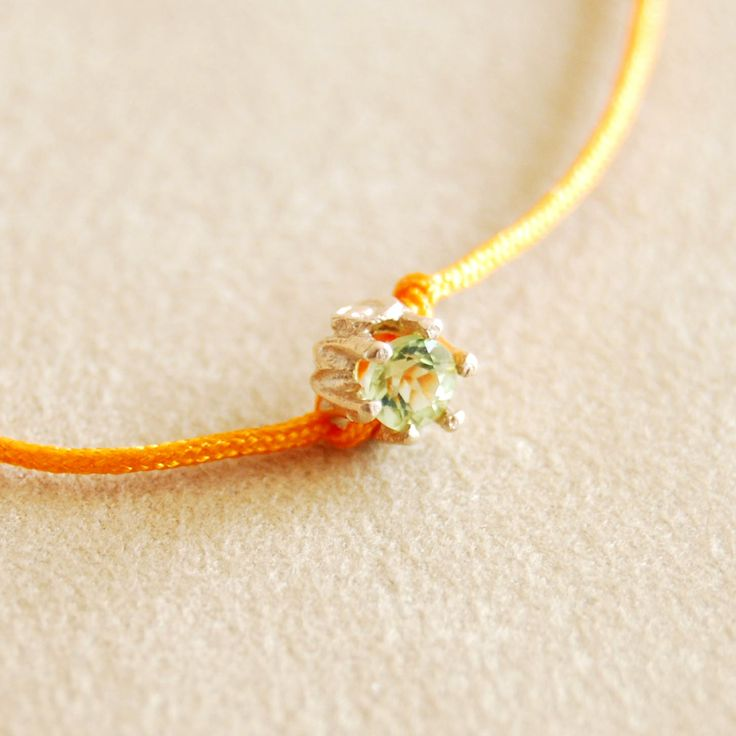 Cristina Zazo SS14, Point bracelet with peridot, orange string #cristinazazo #bracelet #peridot
