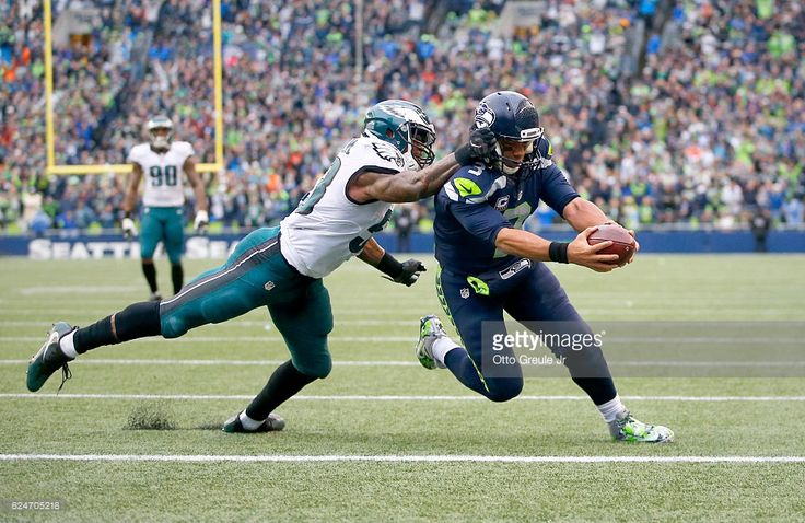 Quarterback Russell Wilson #3 of the Seattle Seahawks scores a touchdown against linebacker Najee Goode #52 of the Philadelphia Eagles at CenturyLink Field on November 20, 2016 in Seattle, Washington.