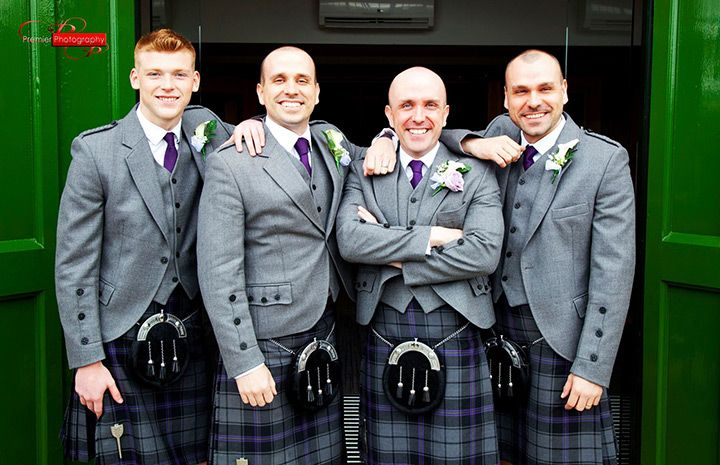 love the pop of purple in the groom and groomsmens' kilts!