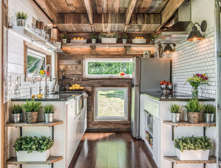 we have come across some very cool tiny houses over the years but nothing beats this the barn inspired alpha tiny house by nashville based new frontier