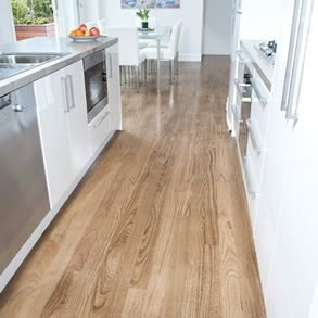 "Australian-grown New England Oak in classic grade, 85mm x 19mm Boral solid strip timber flooring, stained with Bona ""traffic"" in Jacobean."