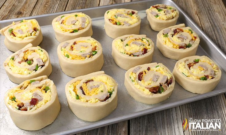 Cheesy Sausage Breakfast Pinwheels are a simple recipe made with soft and tender bread filled with your favorite breakfast fixin's. It's like unrolling a little piece of heaven loaded with smoky bacon, pork sausage, scrambled eggs and ooey gooey cheese! The best part is you can make them ahead so they are perfect for back to school. Have fun making them with the kids on the weekend. Then heat them up and grab one as they are heading out the door!