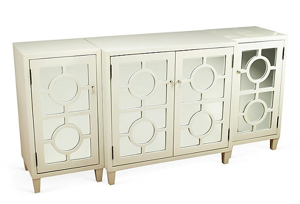 This cabinet would be great if  you put a different color behind the white cutouts on the doors!!!