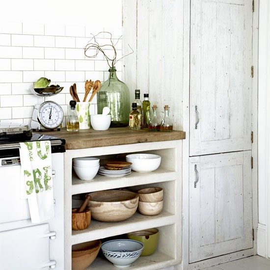 Open shelves mean rustic and decorative bowls aren't hidden away.