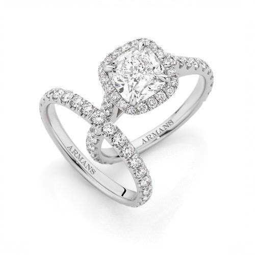 A timeless design of beauty and brilliance. This stunning 2.00-carat cushion halo engagement ring features a beautiful diamond that is delicately claw set and surrounded by a halo of round brilliant cut diamonds. See more at http://www.armansfinejewellery.com/engagement-rings