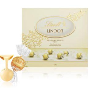 A bulk box of White Chocolate Lindor Balls.