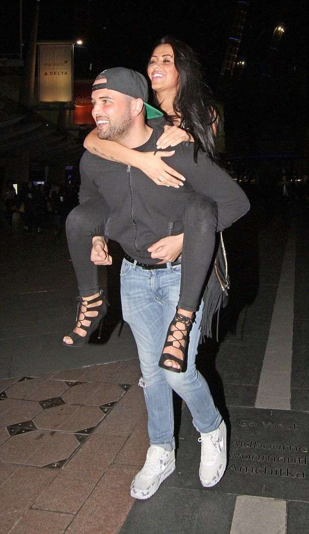 Young love! Ricky Rayment and Marnie Simpson were all over each other as they made their w...