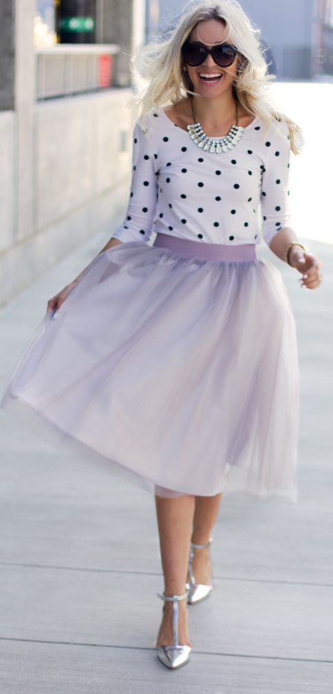 Statement necklace, a black and white polka dot shirt, a lavender tulle skirt, and white flats.