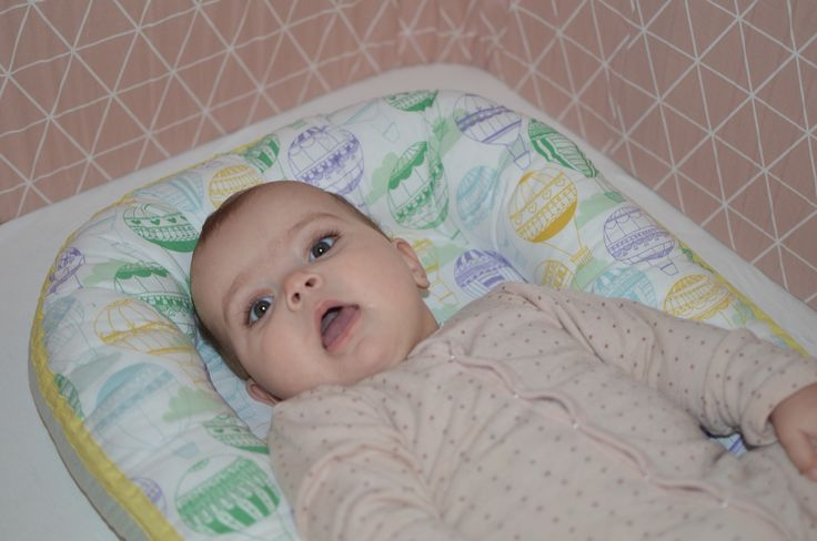 Relaxing in her babynest