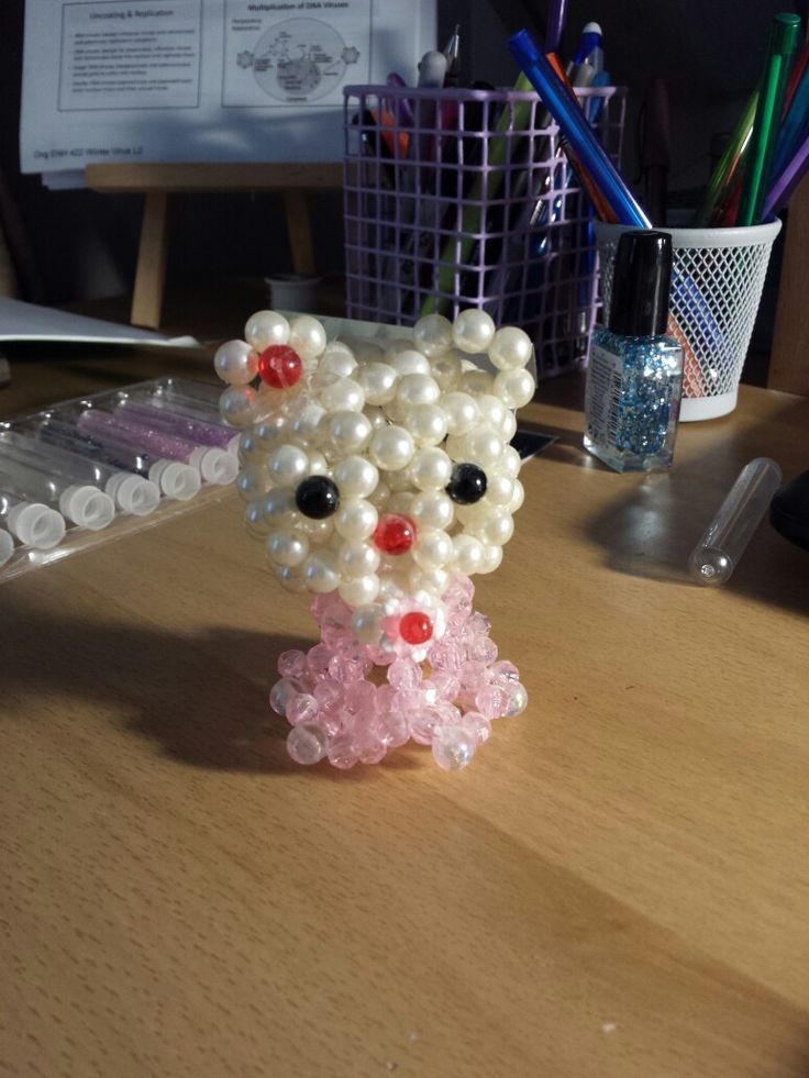 this wasn't made by me but itsnt it cute?    tags: hello Kitty seed bead beaded animal beaded figure