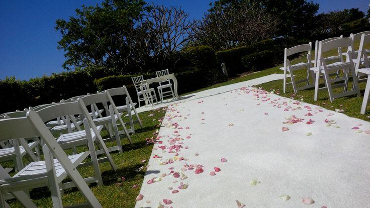 #weddingceremony #rosepetals #whitefoldingchairs #whitecarpet