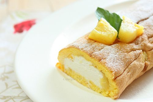 Swiss roll with coconut cream, pineapple and mango