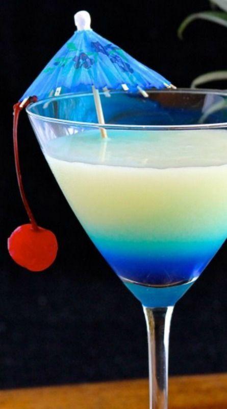 Pina Colada-tini - 2 oz. rum, 1 oz. coconut rum, 2 oz. pineapple juice, 1 oz. cream of coconut,1/2 oz. blue curaçao Garnish as desired