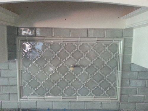 Over the stove. White Subway/white grout and blue glass Arabesque tile for kitchen backsplash