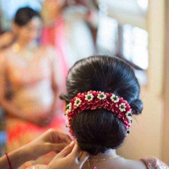 Not starting this series with the #classic #jasmine Gajra .. Here is a #beautiful #Gajra in #red & #white .. Being adorned by a #southasian #bride #loveit #hairstyle #bun #flowers #lowbun #hairporn #dressedup #bridal  GAJRA: A GARLAND OF FLOWERS #GAJRASERIES #ISFGAJRA : clickmenow.in {A series by: @nitikaduggal29 }