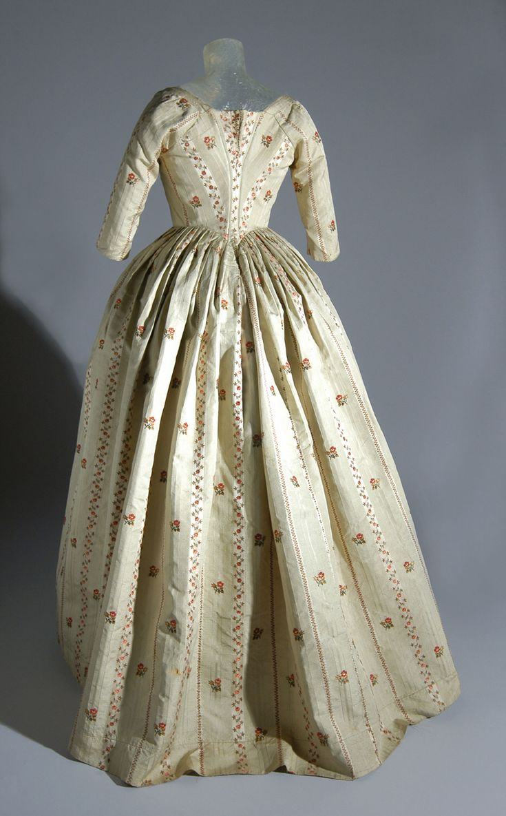 Back view, robe à l'Anglaise, United States, c. 1783, fabric: 1772-1773. Cream silk satin and tobine (cannelé) stripes brocaded with coloured silks.