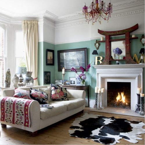great mix of styles here- cow hide rug, suzani, color blocking with the paint