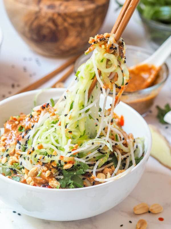Vegan + GF Asian noodle salad mad with cucumbers, rice noodles, mint + cilantro and topped with a creamy almond ginger dressing. Ready in 30 mins. | avocadopesto.com