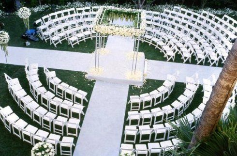Very cool wedding ceremony seating arrangment. I love that all your guests surround the bride & groom