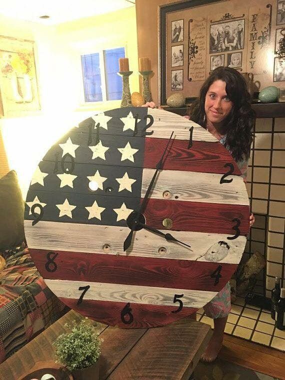 Use an old wooden cable reel to make this large  American flag clock.