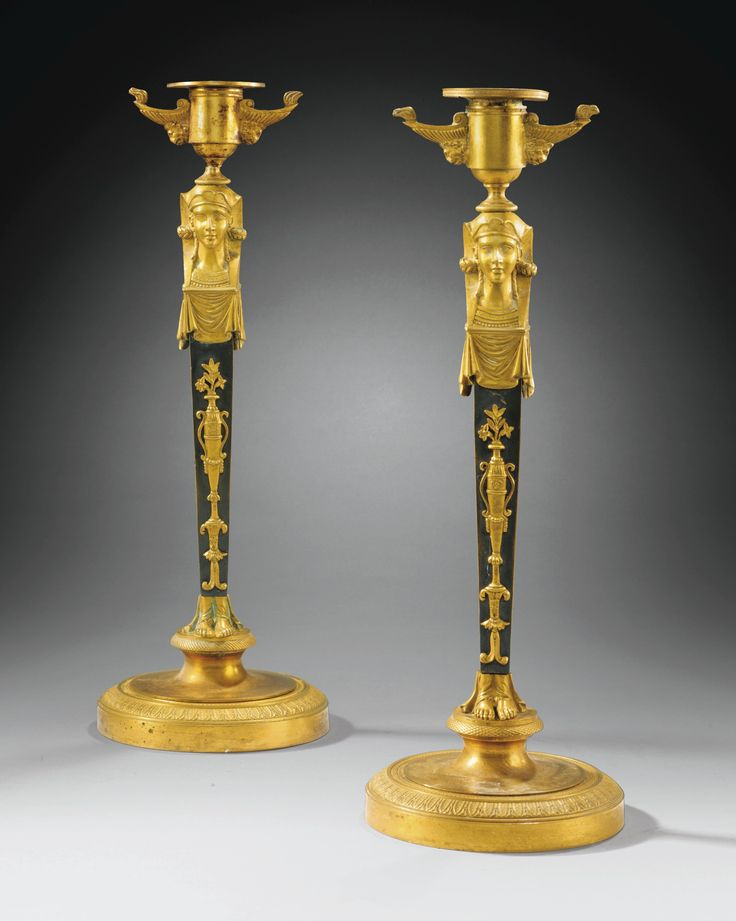 A PAIR OF PATINATED AND GILT-BRONZE CANDLESTICKS, EMPIRE