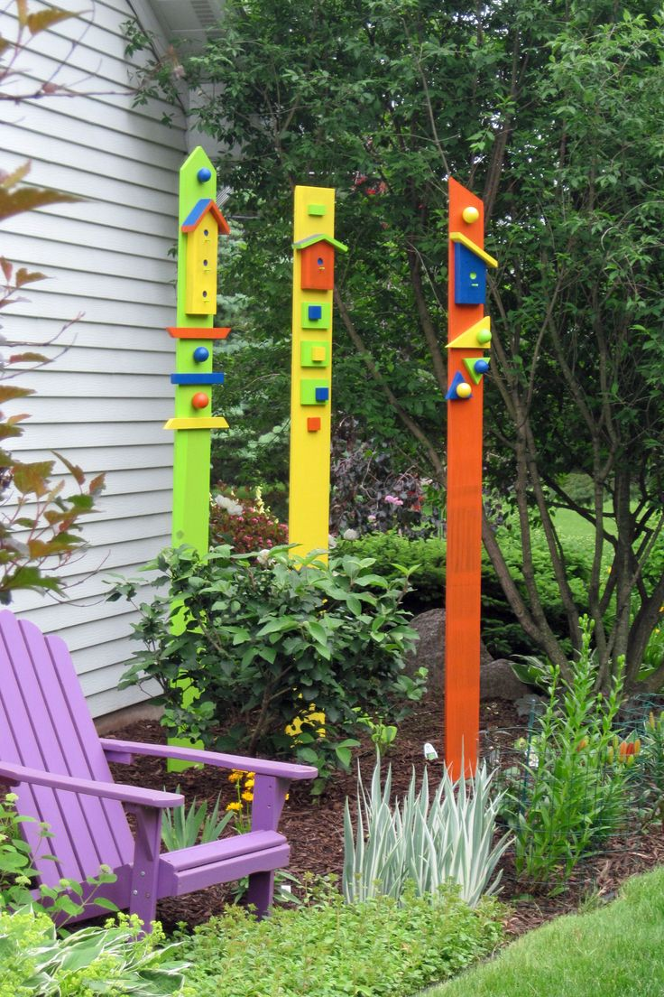 Wooden garden totems created using old fence boards and ...