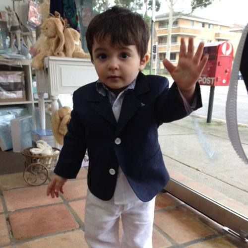 How Cute! Gorgeous Little 18 Month Old Archie Trying on an Alexandros Navy Boys Suit for a Special Family Wedding he is Attending in Greece