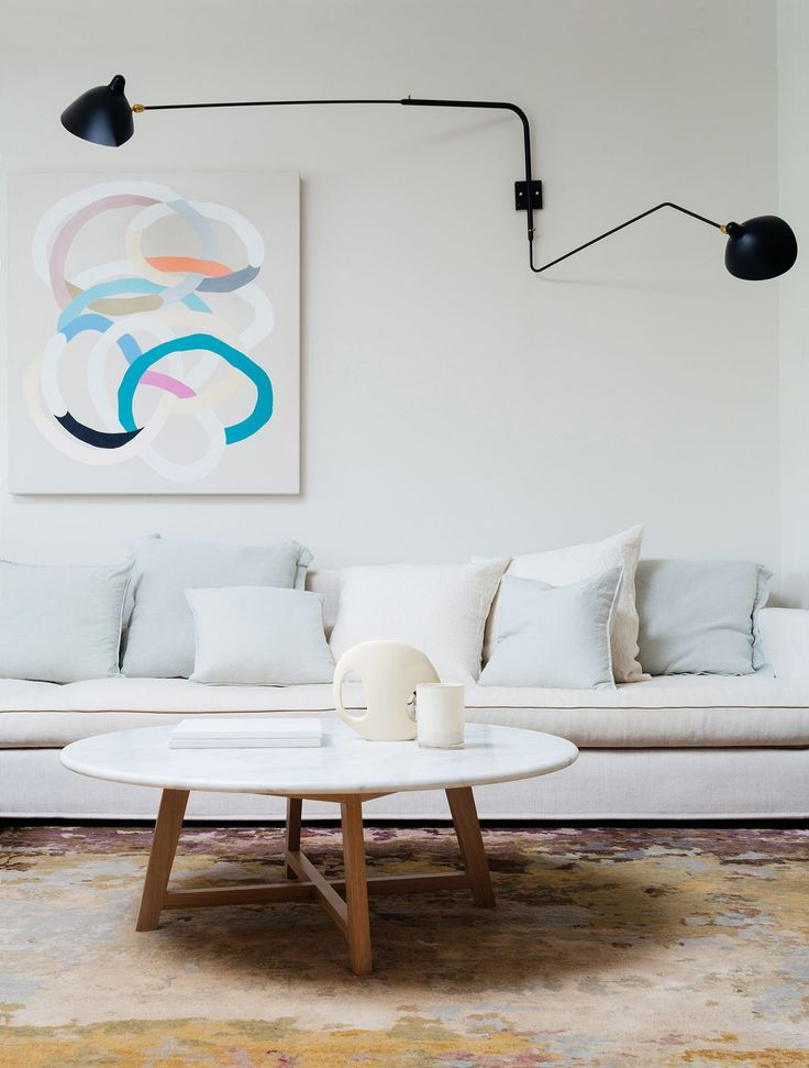 Living Room Long White Sofa With White And Pale Blue Scatter Cushions Iko Round White Coffee Tablesmarble
