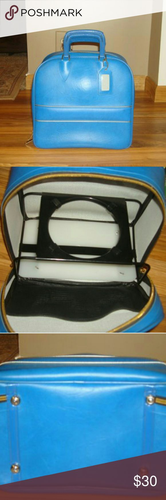 Vintage Blue Single Ball Vinyl BOWLING Bag This Vintage royal Blue Bowling Bag has silver metallic pinstripes across the front and back. It has a metal ball rack inside, the zipper works fine and the handles are in great shape. It is 14x13x8.5 inches. Vintage Bags Totes