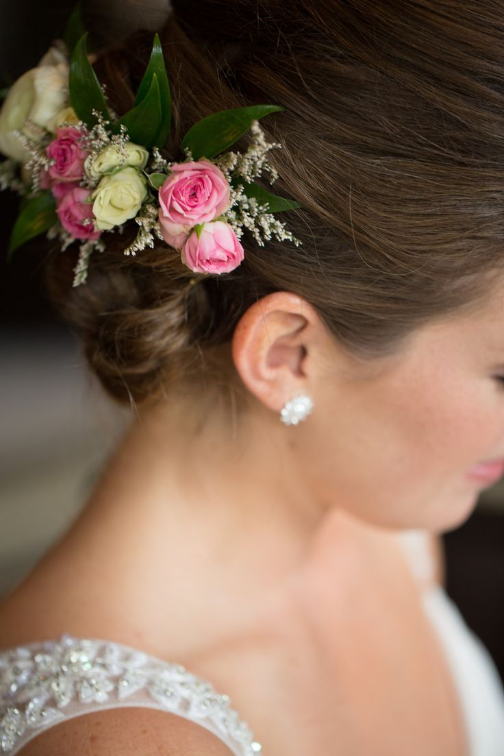 We love nothing more than a bridal headpiece especially when it's made with floral | Pink and white flowers | Diamond stud earrings | Bridal updo | Venue: St. Marys Golf & Country Club | Photography: Maigan Cowen | Floral Design: Lyric Flowers | Event Styling: Above & Beyond Event Design