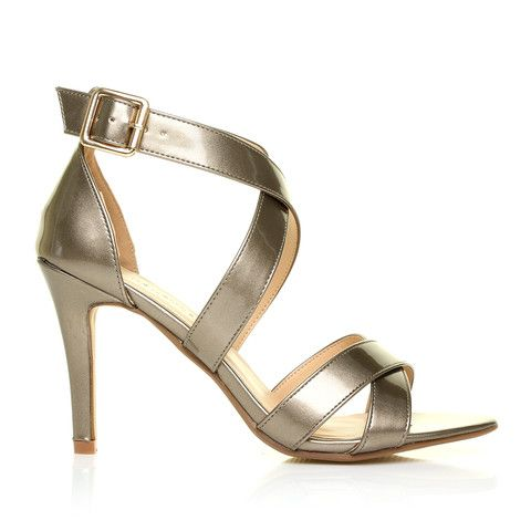 SOPHIE Antique Gold Metallic Strappy High Heel Sandals – ShuWish UK - The SOPHIE Antique Gold Metallic Strappy High Heel Sandals set the gold standard for elegant footwear that is perfect for special occasions. Made of premium metallic gold vegan leather, the sandals feature criss cross straps at the ankles and at the toes. Their 3.5-inch heels will give you that perfect lift.